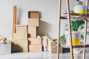 Belongings packed in cardboard boxes from moving long distance to a new home